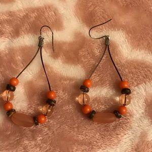 Brown orange bead dangle earrings
